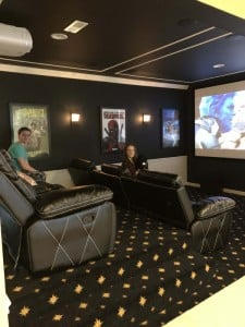 carpeted home theater blurred faces
