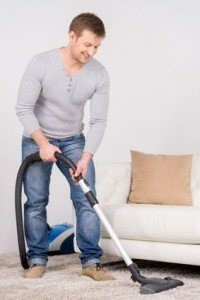 Area Rug man vacuumming